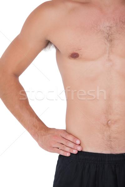 Encajar sin camisa hombre mano cadera blanco Foto stock © wavebreak_media