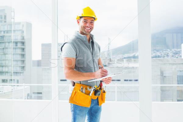 Manual worker writing on clipboard in building Stock photo © wavebreak_media