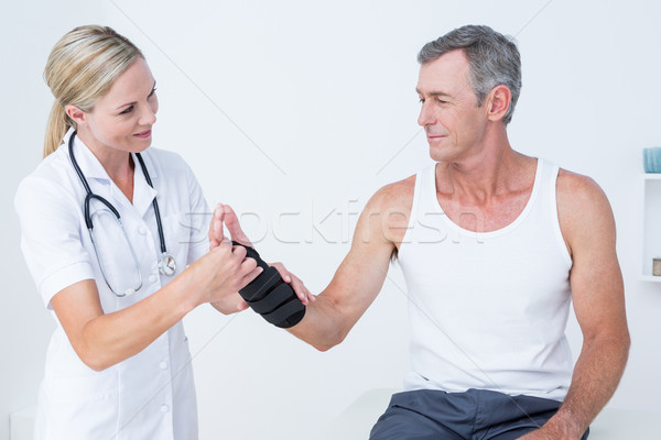Doctor examining a man wrist Stock photo © wavebreak_media