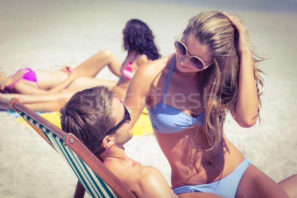 幸せ カップル リラックス デッキ 椅子 ビーチ ストックフォト © wavebreak_media