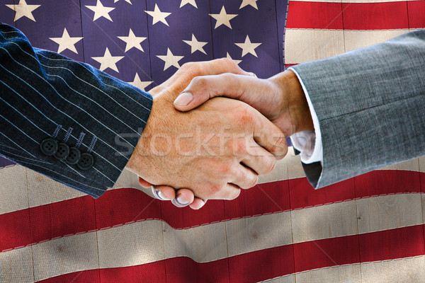 Composite image of business people shaking hands Stock photo © wavebreak_media