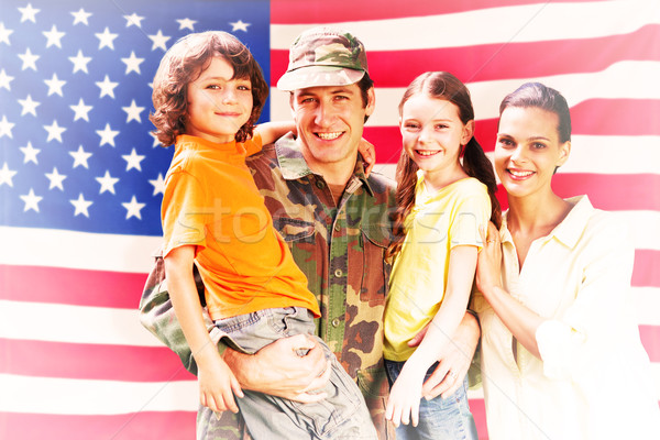 Composite image of solider reunited with family Stock photo © wavebreak_media