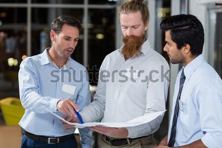 Therapist advising his listening patient Stock photo © wavebreak_media