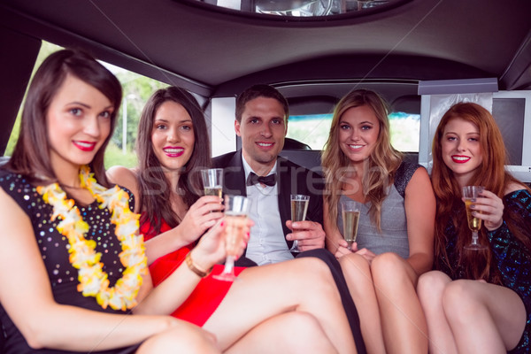 Happy friends drinking champagne in limousine Stock photo © wavebreak_media