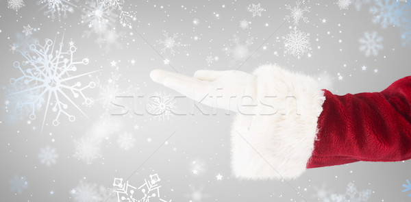 Composite image of santa claus shows open hand Stock photo © wavebreak_media