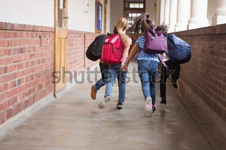 Cute uczniowie uruchomiony w dół sali szkoła podstawowa Zdjęcia stock © wavebreak_media