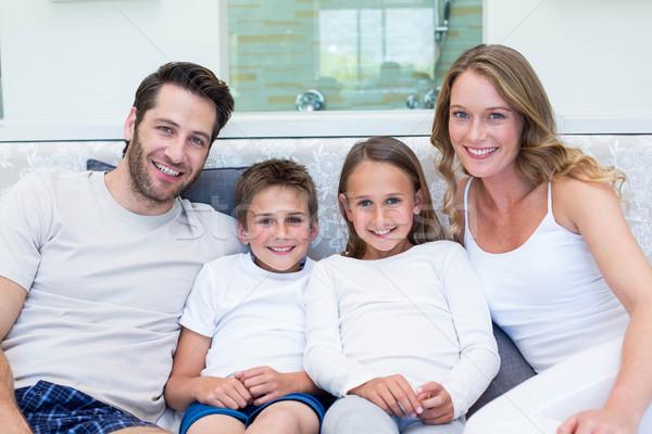 Boldog család mosolyog kamera otthon hálószoba ház Stock fotó © wavebreak_media