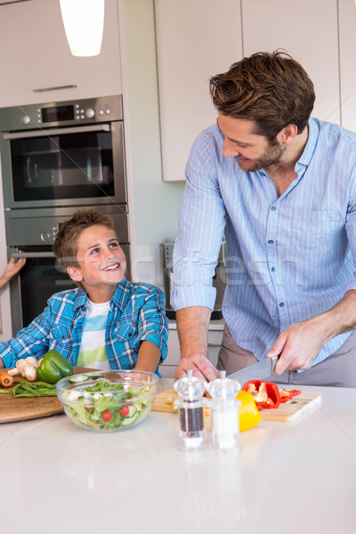 Happy family preparing vegetables together Stock photo © wavebreak_media