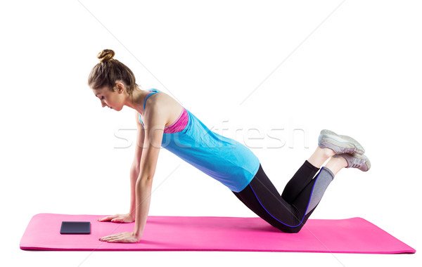 Fit woman doing press up on mat Stock photo © wavebreak_media