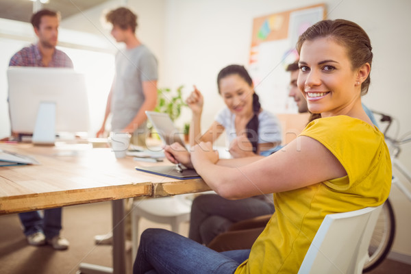 Smiling young businesswoman in a meeting Stock photo © wavebreak_media