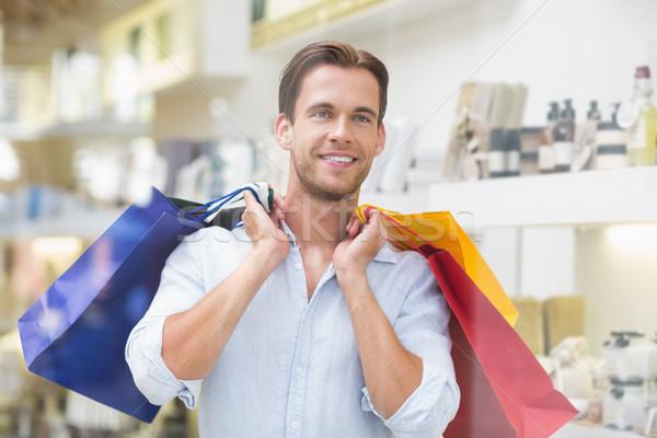 ストックフォト: 笑みを浮かべて · 男 · ショッピングバッグ · モール · 顧客 · 男性