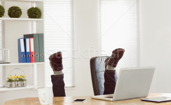 Businessman upside down at his desk Stock photo © wavebreak_media