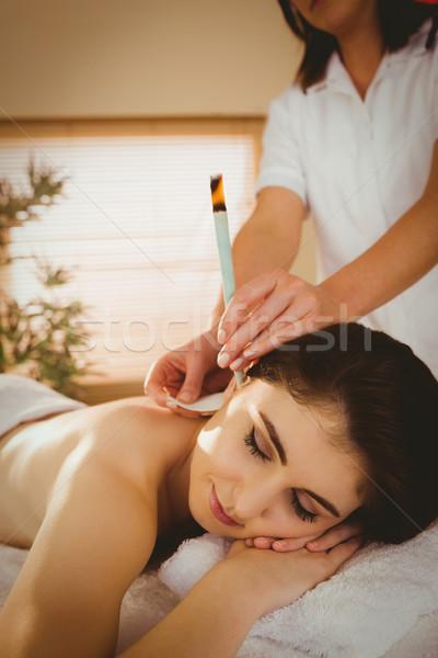 Mulher jovem ouvido tratamento terapia quarto mulher Foto stock © wavebreak_media