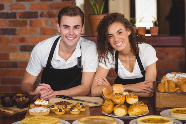 Smiling waiter and waitress leaning on counter Stock photo © wavebreak_media