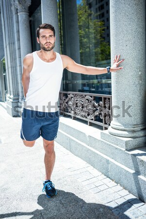 Handsome athlete skipping with jump rope Stock photo © wavebreak_media