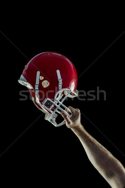 American football player holding up his helmet Stock photo © wavebreak_media