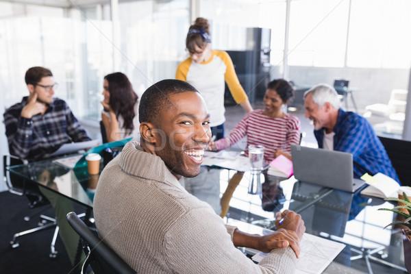 笑みを浮かべて ビジネスマン 座って 会議 同僚 オフィス ストックフォト © wavebreak_media