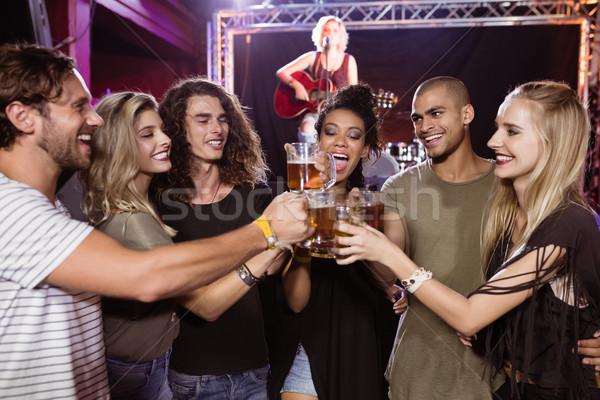 Mosolyog barátok pirít sör szemüveg előadó Stock fotó © wavebreak_media