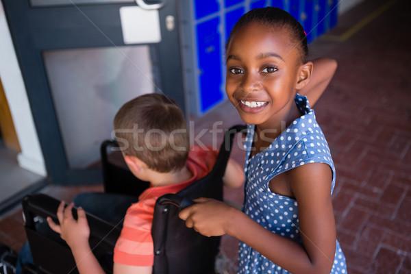 Portré mosolyog lány osztálytárs iskola folyosó Stock fotó © wavebreak_media
