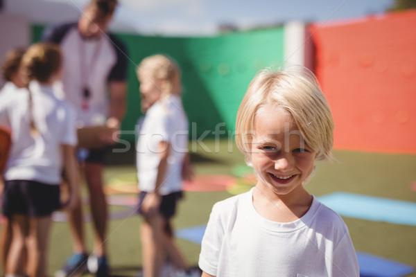Feliz aluna uniforme retrato menina homem Foto stock © wavebreak_media