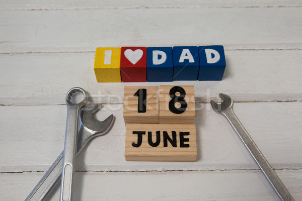 Cube shapes with text by calender date and spanners on table Stock photo © wavebreak_media
