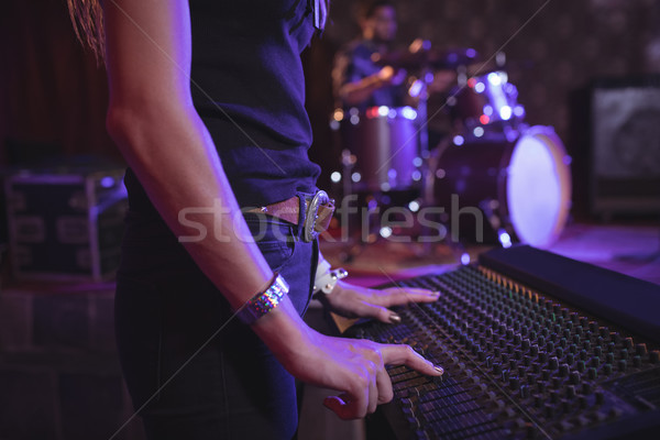 Mid section of female musician operating sound mixer  Stock photo © wavebreak_media