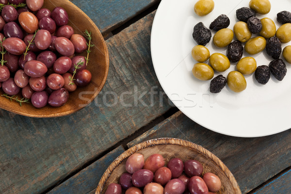 Olives in bowls and plate Stock photo © wavebreak_media