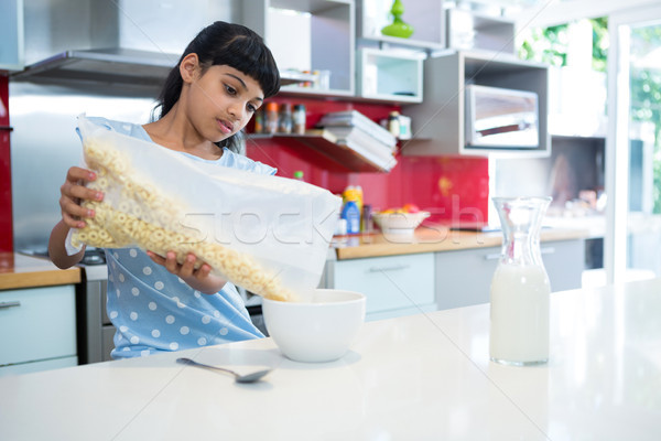 Girl pouring breakfast cereal in bowl Stock photo © wavebreak_media