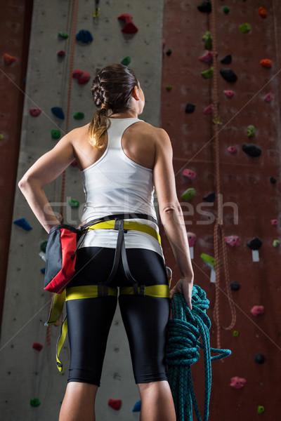 Woman standing with hands on hip in fitness studio Stock photo © wavebreak_media