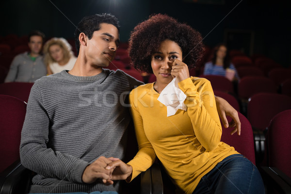 Sad couple watching movie in theatre Stock photo © wavebreak_media