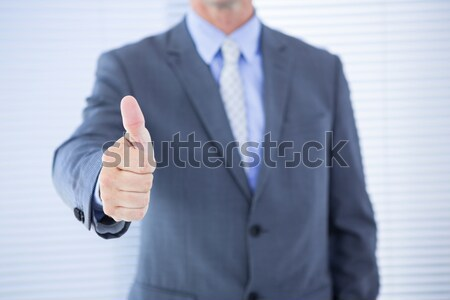 Midsection of man pointing finger Stock photo © wavebreak_media