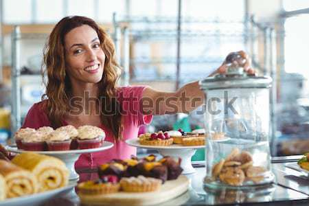 Portrait of smiling young waitress carrying food in wicker baskets Stock photo © wavebreak_media