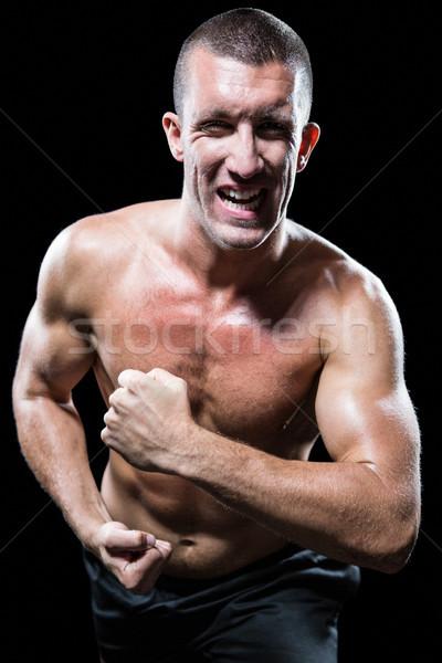 Heyecanlı gömleksiz adam kaslar portre siyah Stok fotoğraf © wavebreak_media