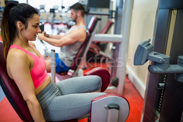 Woman using weights machine for her legs Stock photo © wavebreak_media