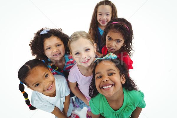 Sorridere ragazze tutti guardando felice bambino Foto d'archivio © wavebreak_media