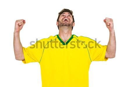 Jóképű férfi felfelé néz kezek fehér képernyő férfi Stock fotó © wavebreak_media