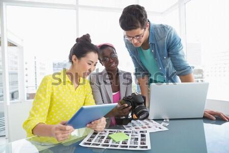 Team of graphic designers discussing over document Stock photo © wavebreak_media