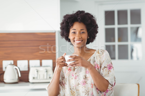 Portrait of smiling woman holding white cup Stock photo © wavebreak_media