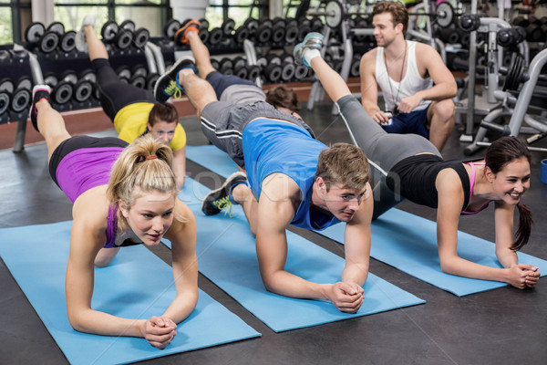 Group of people working their abs Stock photo © wavebreak_media