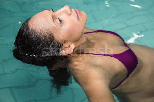 Pregnant woman floating in the pool Stock photo © wavebreak_media