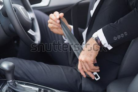 Auto service staff cleaning car with portable vacuum Stock photo © wavebreak_media