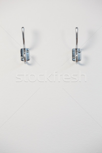 Hooks attached on wall Stock photo © wavebreak_media