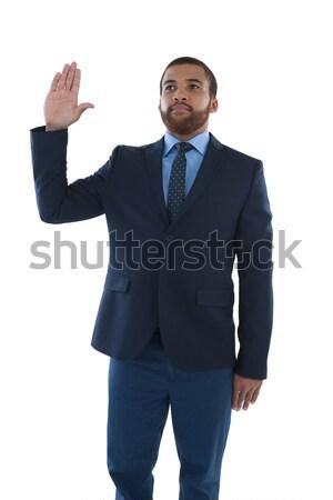 Businessman making stop sign against white background Stock photo © wavebreak_media