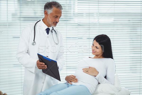 Doctor examining pregnant woman Stock photo © wavebreak_media