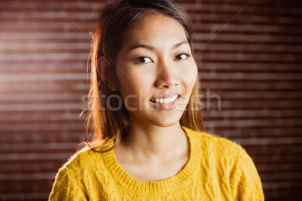 Cute asian woman smiling Stock photo © wavebreak_media