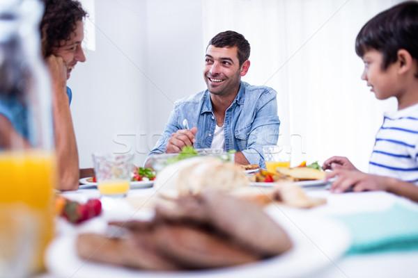 Family sitting at breakfast table Stock photo © wavebreak_media