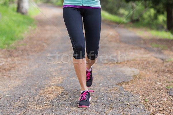 Low section of woman running on footpath Stock photo © wavebreak_media