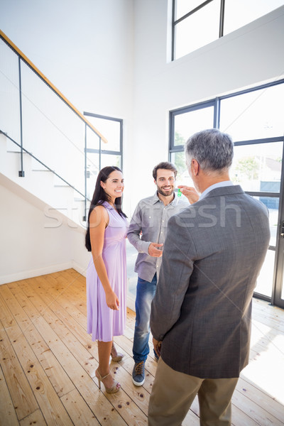 Real-estate agent giving keys to couple Stock photo © wavebreak_media