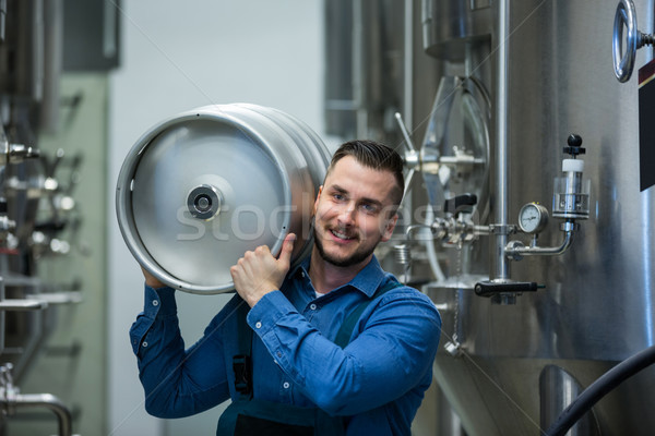 Portrait of brewer carrying keg Stock photo © wavebreak_media