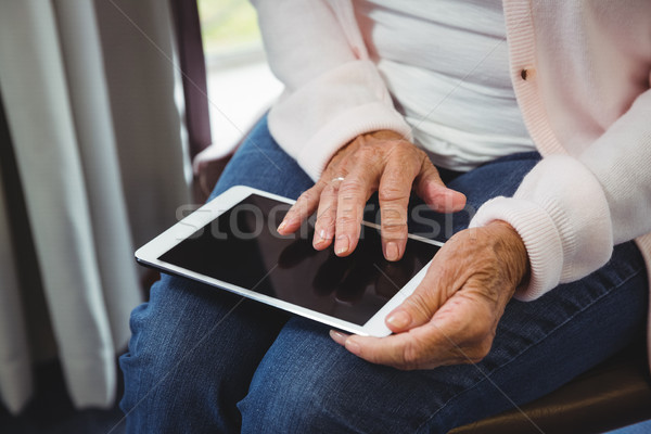 Senior woman using a digital tablet Stock photo © wavebreak_media
